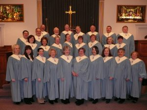 A large adult choir stands in Lower Providence Presbyterian Church